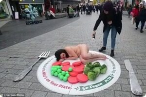 Going Cold Turkey: Naked Woman Lies Down on a Plate of Vegetables in Liverpool City Centre in Protest against Traditional Christmas Dinners 7