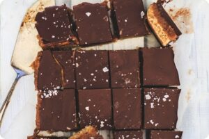 Indulgent Caramel Millionaires Shortbread Slices with Ombar Chocolate 13